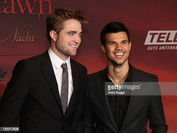 Actors Robert Pattinson and Taylor Lautner attend the Germany Premiere of 'The Twilight Saga Breaking Dawn Part 1 Biss zum Ende der Nacht' at...
