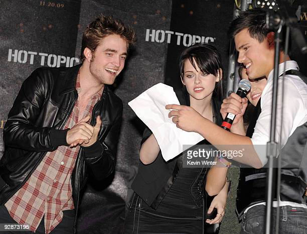 Actors Robert Pattinson Kristen Stewart and Taylor Lautner appear onstage at Summit's The Twilight Saga New Moon Cast Tour at Hollywood and Highland...