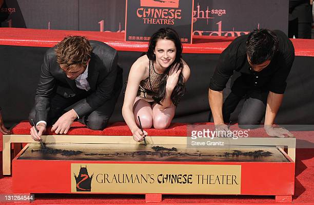 Actors Robert Pattinson Kristen Stewart and Taylor Lautner attend their Hand and Footprint Ceremony at Grauman's Chinese Theatre on November 3 2011...