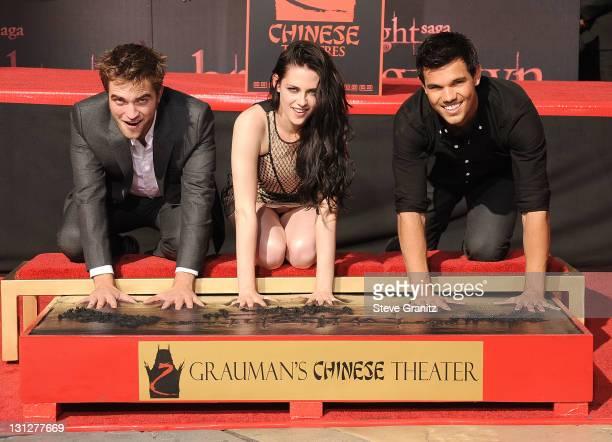 Actors Robert Pattinson Kristen Stewart and Taylor Lautner attends the Kristen Stewart Robert Pattinson And Taylor Lautner Hand And Footprint...