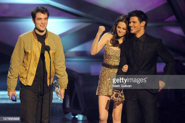 Actors Robert Pattinson Kristen Stewart and Taylor Lautner onstage during the 2011 People's Choice Awards at Nokia Theatre LA Live on January 5 2011...
