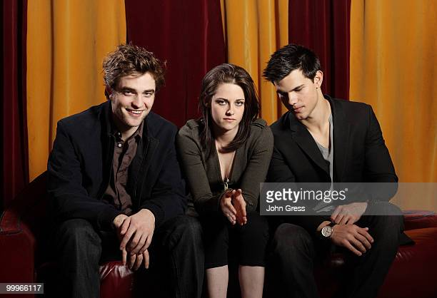 Actors Robert Pattinson Kristen Stewart and Taylor Lautner pose for a private photo shoot at Marche on May 5 2010 in Chicago Illinois