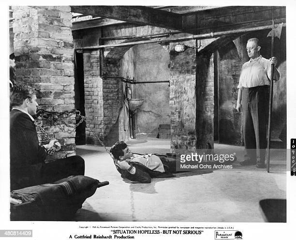 Actors Robert Redford Mike Connors and Alec Guinness on set the movie 'Situation Hopeless But Not Serious' circa 1965