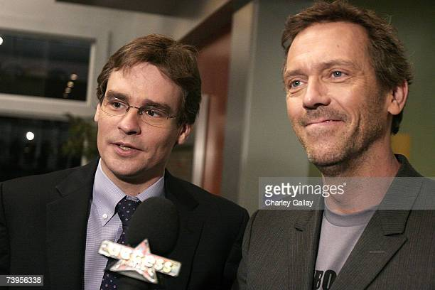 Actors Robert Sean Leonard and Hugh Laurie being interviewed at the announcement of the creation of exclusive ''Houseism'' tshirts to benefit the...
