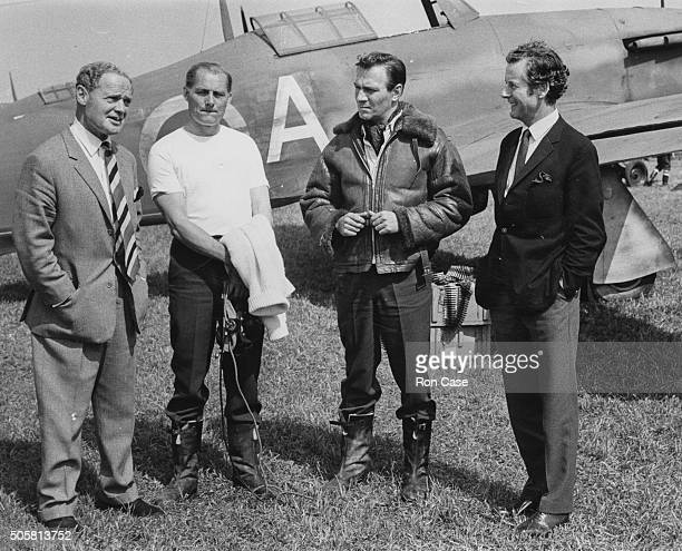 Actors Robert Shaw and Christopher Plummer talking to pilots Group Captain Bade and Group Captain Peter Townsend about the making of the film 'The...