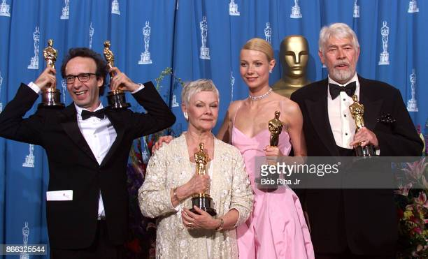 Actors Roberto Benigni Judi Dench Gwyneth Paltrow and James Coburn at the 71st Annual Academy Awards March 21 1999 In Los Angeles California