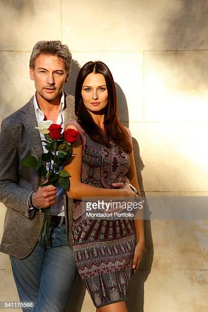 Actors Roberto Farnesi and Anna Safroncik starring in the third season of Le tre rose di Eva in Villa Borghese Rome Italy 3rd March 2015