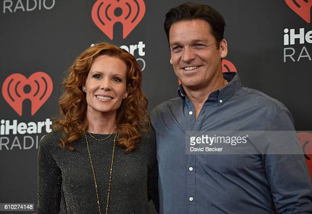 Actors Robyn Lively and Bart Johnson attend the 2016 iHeartRadio Music Festival at TMobile Arena on September 24 2016 in Las Vegas Nevada