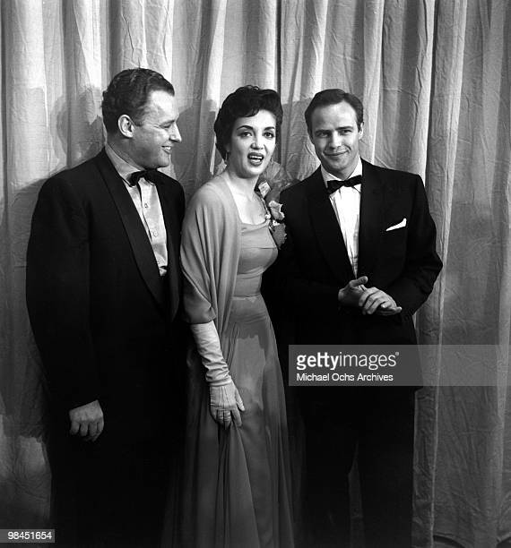 Actors Rod Steiger Katy Jurado and Marlon Brando pose for a portrait at the Academy Awards on March 30 1955 in Los Angeles California