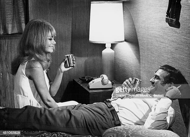 Actors Rod Taylor and Ahna Capri in a scene from the movie 'Darker Than Amber' 1970