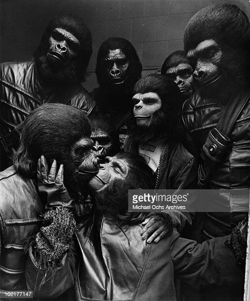 Actors Roddy McDowall Natalie Trundy and Bobby Porter in a scene from the movie 'Battle for the Planet of the Apes' in 1973 in Los Angeles California