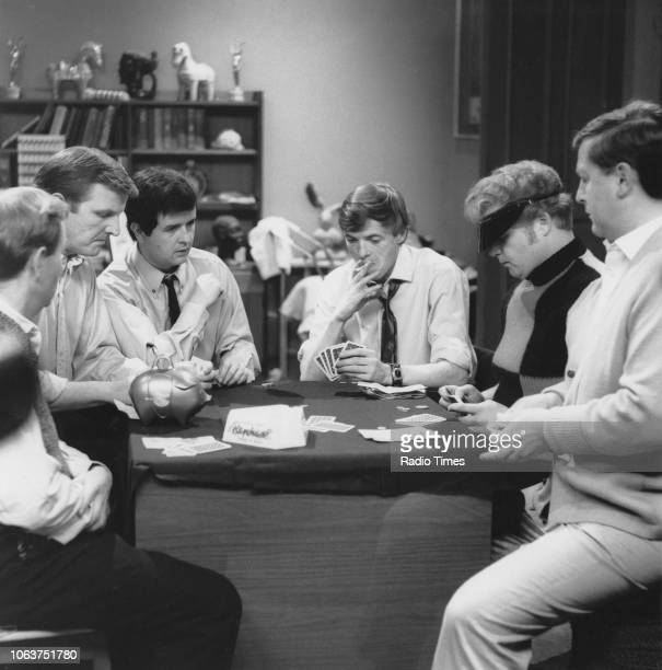 Actors Rodney Bewes and James Bolam playing cards with a group of men in a scene from 'The Likely Lads' episode 'Love and Marriage' July 8th 1966
