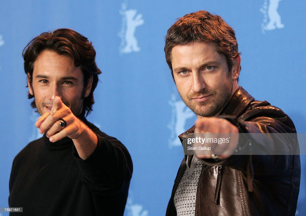 Actors Rodrigo Santoro (L) and Gerard Butler attend a photocall to promote the movie '300' during the 57th Berlin International Film Festival (Berlinale) on February 14, 2007 in Berlin, Germany.