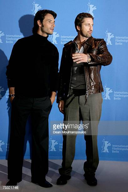 Actors Rodrigo Santoro and Gerard Butler attend a photocall to promote the movie '300' during the 57th Berlin International Film Festival on February...