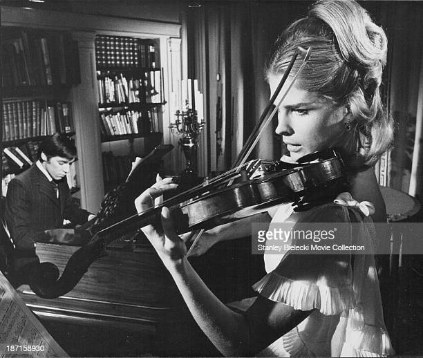 Actors Roger Lloyd Pack and Candice Bergen in a scene from the film 'The Magus' 1968