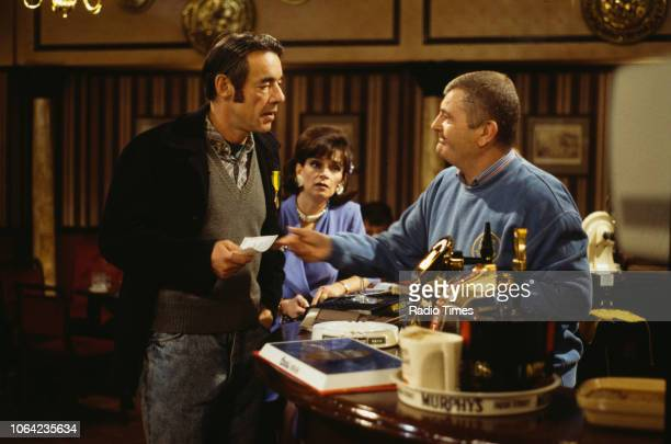 Actors Roger LloydPack Sue Holderness and Kenneth MacDonald in a pub scene from the Christmas special episode 'Rodney Come Home' of the BBC...
