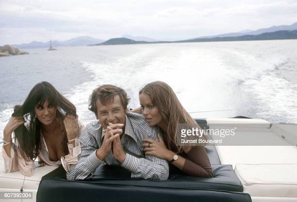 Actors Roger Moore actresses Caroline Munro and Barbara Bach on the set of The Spy Who Loved Me