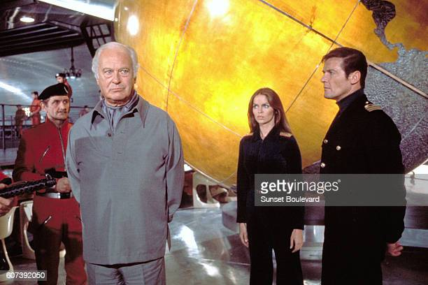 Actors Roger Moore Curd Jurgens and actress Barbara Bach on the set of The Spy Who Loved Me