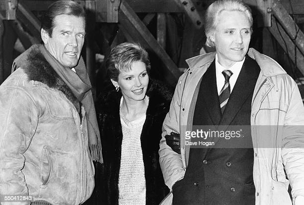Actors Roger Moore Fiona Fullerton and Christopher Walken on the set of the James Bond film 'A View to a Kill' circa 1984