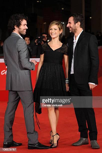 Actors Romain Duris and Marina Fois and director Eric Lartigau attend the 'L'Homme Qui Voulait Vivre Sa Vie' premiere during The 5th International...