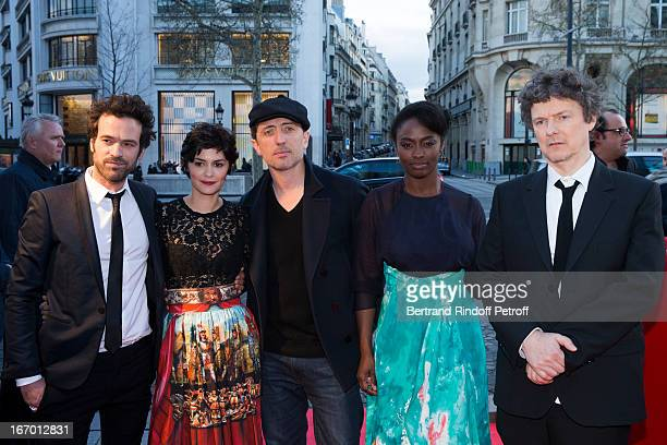 Actors Romain Duris Audrey Tautou Gad Elmaleh Aissa Maiga and director Michel Gondry pose upon their arrival to the premiere of Gondry's film...
