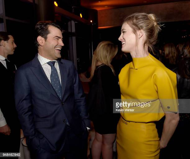 Actors Ron Livingston and Mackenzie Davis talk at the after party for the premiere of Focus Features' 'Tully' at WP24 on April 18 2018 in Los Angeles...