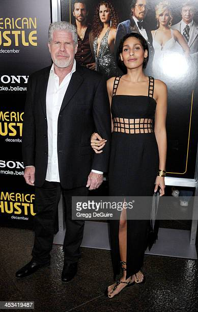 Actors Ron Perlman and daughter Blake Perlman arrive at the Los Angeles premiere of 'American Hustle' at Directors Guild Theatre on December 3 2013...