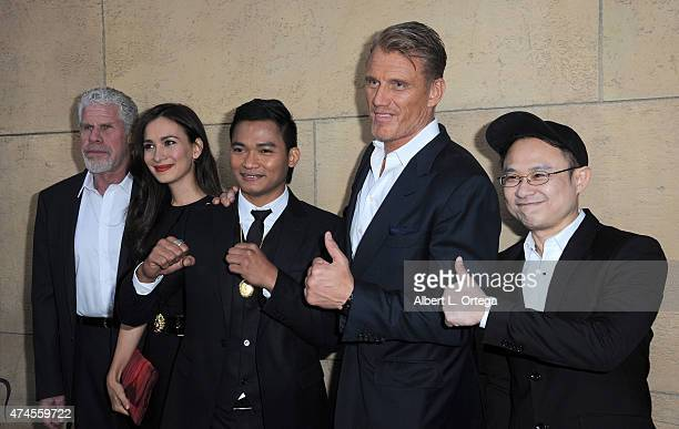 Actors Ron Perlman Celina Jade Tony Jaa Dolph Lundgren and director Ekachai Uekrongtham arrives for the premiere Of 'Skin Trade' held at the Egyptian...