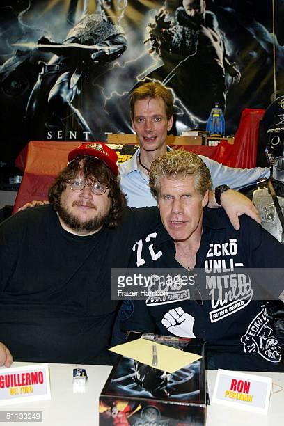 Actors Ron Perlman Doug Jones and Hellboy director Guillermo del Toro attend a Hellboy movie memorabilia signing at Golden Apple Comic Store on...