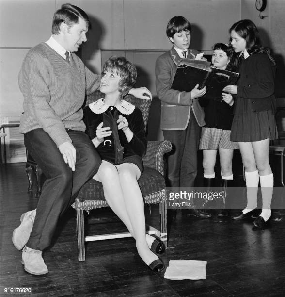 Actors Ronald Hines Wendy Craig Hugo KeithJohnston Roberta Tovey Jill Riddick rehearsing for BBC television show 'Not in Front of the Children' UK...