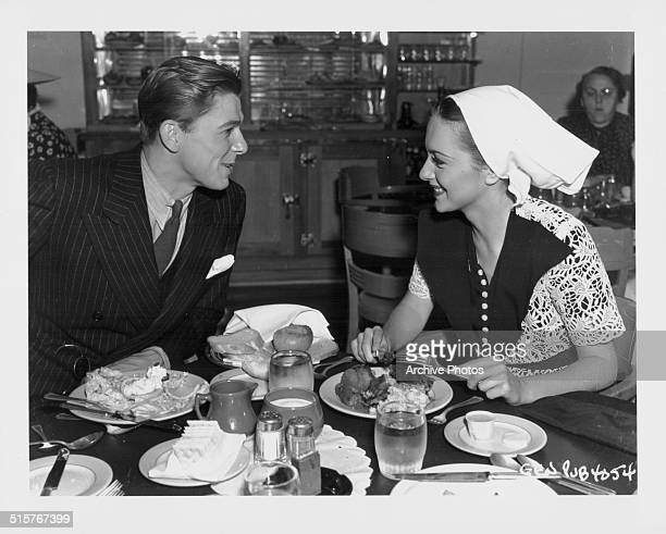 Actors Ronald Reagan and Olivia de Havilland eating lunch together at the Warner Bros Studio commissary Los Angeles 1938
