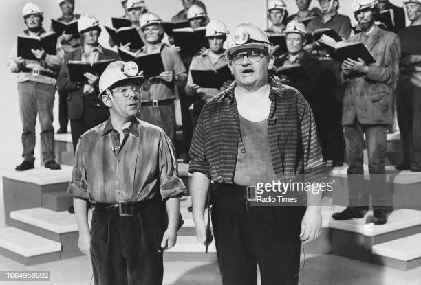 Actors Ronnie Barker and Ronnie Corbett in the 'Welsh mining choir' sketch from the television comedy series 'The Two Ronnies' October 30th 1977