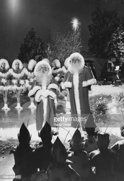 Actors Ronnie Barker and Ronnie Corbett wearing Santa Claus costumes in a sketch from the television comedy series 'The Two Ronnies' December 1st 1984