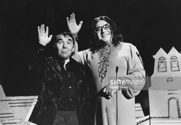 Actors Ronnie Barker in costume as Nana Mouskouri and Ronnie Corbett as Charles Aznavour in a sketch from the television comedy series 'The Two...