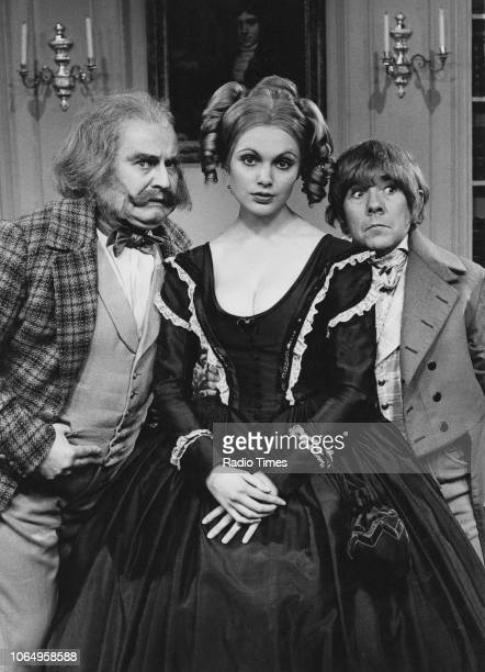 Actors Ronnie Barker Ronnie Corbett and Madeline Smith wearing period costume in the 'classic serial' sketch from the television comedy series 'The...