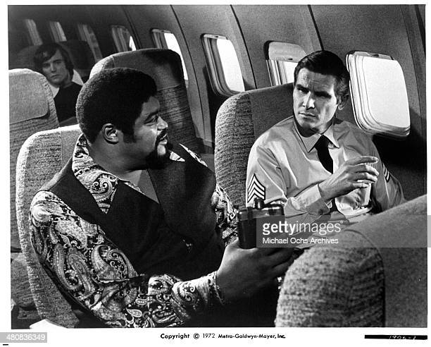 Actors Roosevelt Grier and James Brolin in a scene from the movie Skyjacked circa 1972