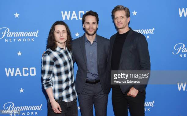 Actors Rory Culkin Taylor Kitsch and Paul Sparks arrive at the Academy of Television Arts and Sciences' screening of WACO at the Sherry Lansing...