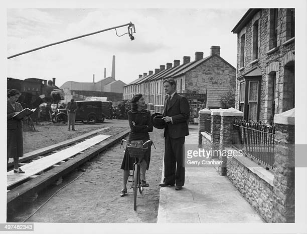 Actors Rosalind Russell and Robert Donat on the set of the film 'The Citadel' at Denham Studios July 11th 1938