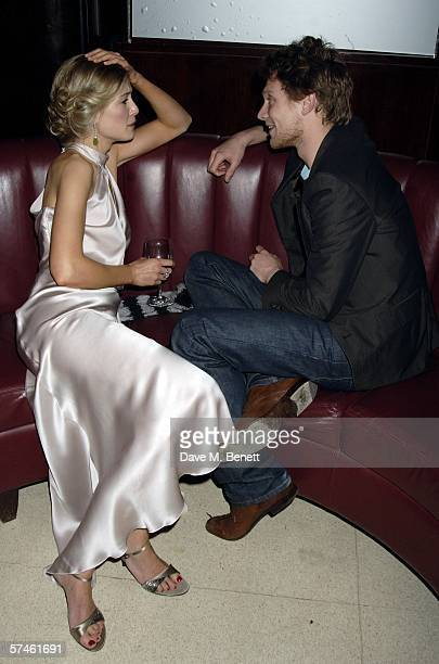 Actors Rosamund Pike and Simon Woods attend the Royal Court Theatre's 50th anniversary party at Titanic on April 26 2006 in London England