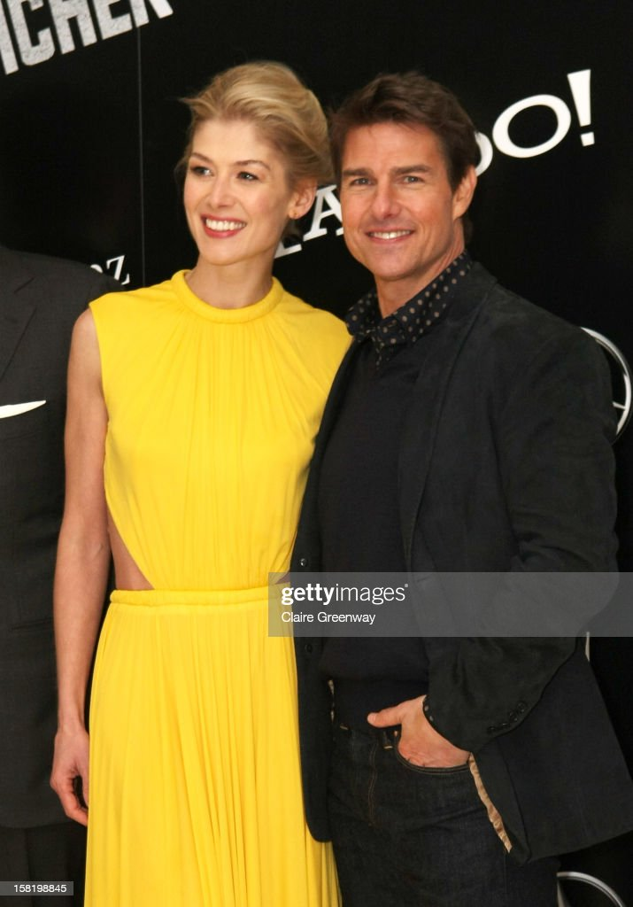 Actors Rosamund Pike and Tom Cruise attend the world premiere of 'Jack Reacher' at The Odeon Leicester Square on December 10, 2012 in London, England.