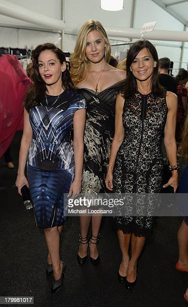 Actors Rose McGowan Maggie Grace and Perrey Reeves backstage at the Monique Lhuillier fashion show during MercedesBenz Fashion Week Spring 2014 at...