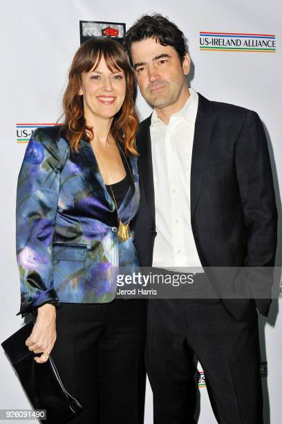 Actors Rosemarie DeWitt and Ron Livingston arrive at the 13th Annual Oscar Wilde Awards on March 1 2018 in Santa Monica California