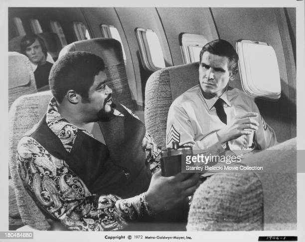 Actors Rosey Grier and Claude Akins in a scene from the movie 'Skyjacked' 1972