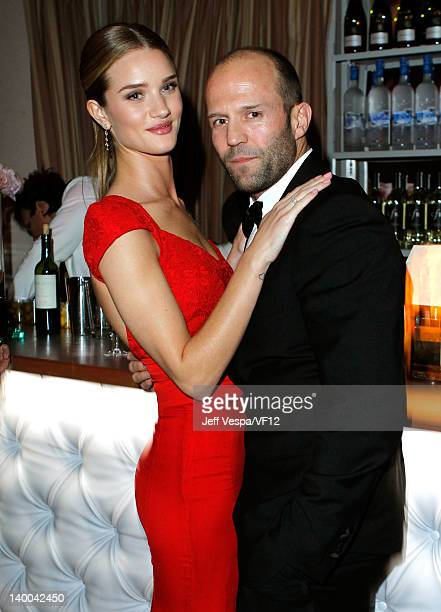 Actors Rosie HuntingtonWhiteley and Jason Statham attend the 2012 Vanity Fair Oscar Party Hosted By Graydon Carter at Sunset Tower on February 26...