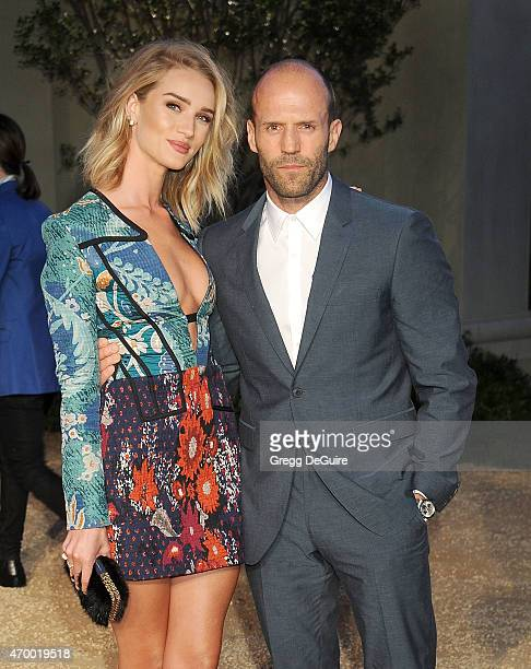 Actors Rosie HuntingtonWhiteley and Jason Statham attend the Burberry London in Los Angeles event at Griffith Observatory on April 16 2015 in Los...