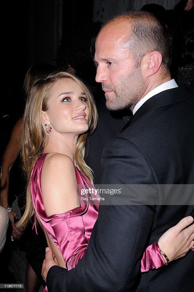 Actors Rosie Huntington-Whiteley (L) and Jason Statham enter the Crown Restaurant on May 2, 2011 in New York City.