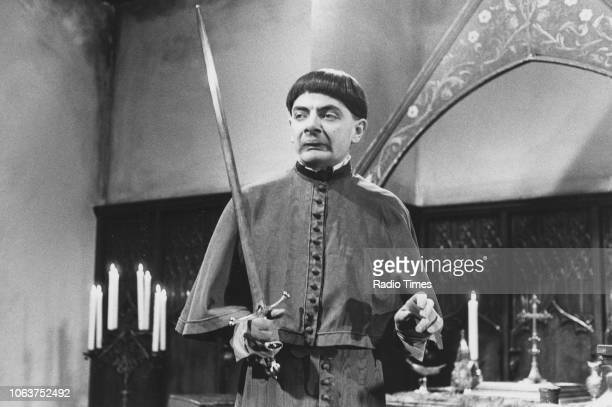 Actors Rowan Atkinson holding a sword in a scene from the television show 'The Black Adder' March 20th 1983