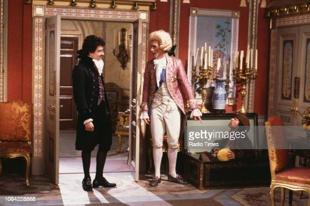 Actors Rowan Atkinson Hugh Laurie and Tony Robinson in a scene from the BBC television sitcom 'Black Adder the Third' June 12th 1987