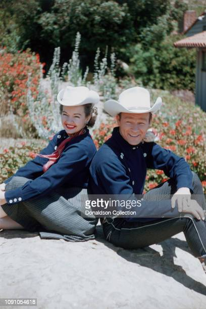 Actors Roy Rogers and Dale Evans pose for a photo on May 12, 1958 in Los Angeles, California.