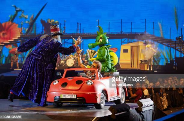 Actors Rufus Beck as Magier , singer Peter Maffay and actress Sophia Schoenert as Tabaluga on stage during the premiere of Peter Maffay's rock...